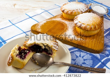 Sweet dessert on the white plate. Sweet dessert. Sweet pastry. Small pie. Pie. Jam pie - stock photo