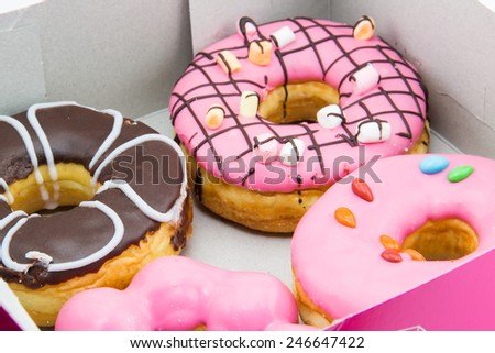 sweet donut in a paper box - stock photo