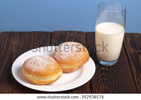 Sweet donuts and glass of milk for breakfast - stock photo