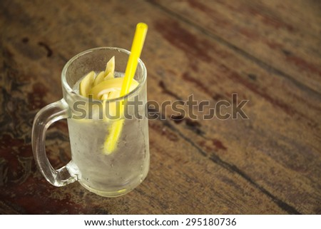 Sweet drinking with mango on wooden desk - stock photo