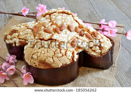 sweet easter cake called colomba made with almond and sugar - stock photo