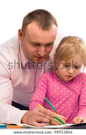 Sweet family drawing on the album at the table. Isolated on white background - stock photo