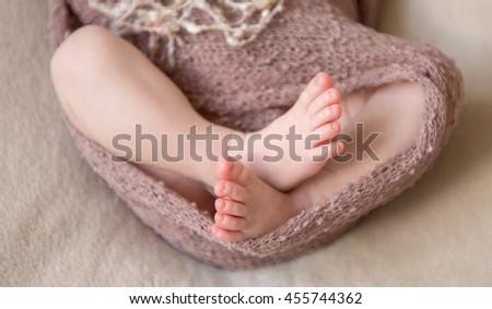 sweet feet of newborn baby close-up - stock photo
