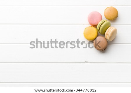 sweet french macarons on white kitchen table - stock photo