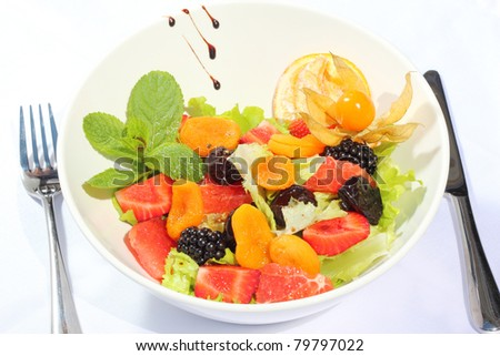 Sweet fresh and tasty fruit salad - stock photo