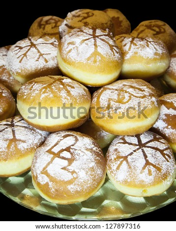 Sweet fresh baked donuts sprinkled with powdered sugar �isolated on black - stock photo