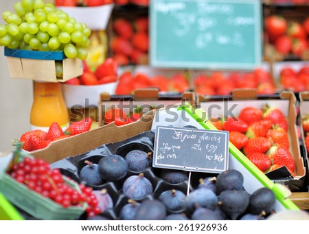 Sweet fresh bio figs and berry on Paris farmer agricultural market - stock photo