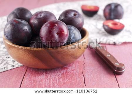 Sweet fresh plum in the bawl - stock photo