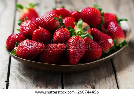 Sweet fresh stawberry on the wooden table, selective focus - stock photo