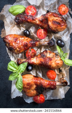 Sweet fried chicken drumsticks with honey and spices from above - stock photo