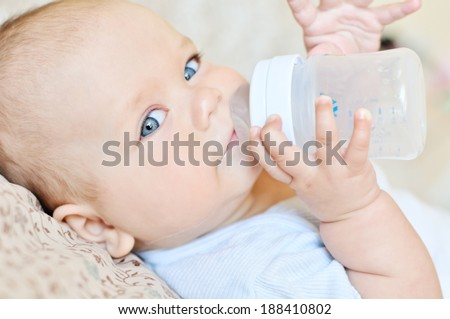 sweet funny baby drinking water