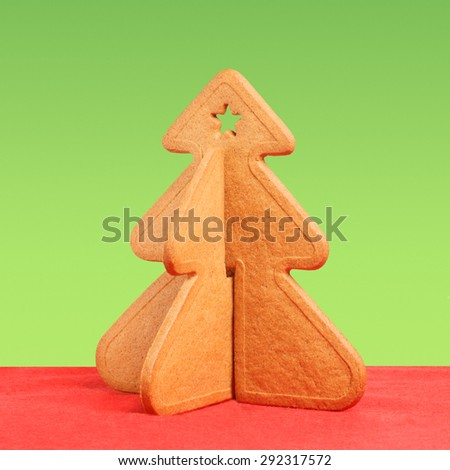 Sweet gingerbread cookie shaped like Christmas tree. Sweet xmas treat decoration - stock photo