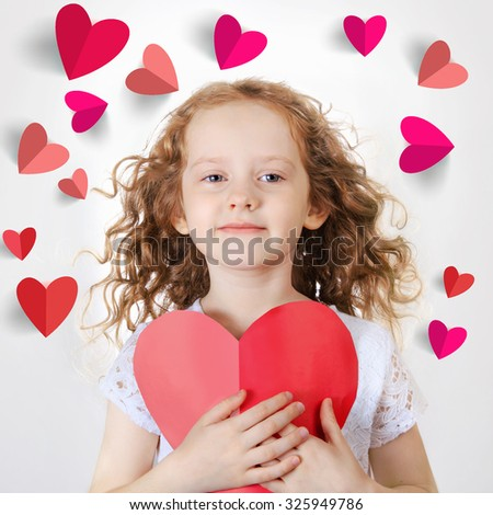 Sweet girl holding red paper heart. Valentines day or healthcare, medical concept.