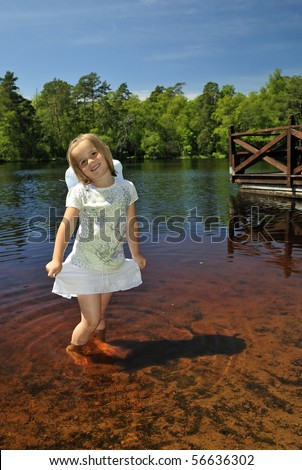 Sweet girl in summer Swedish lake - stock photo