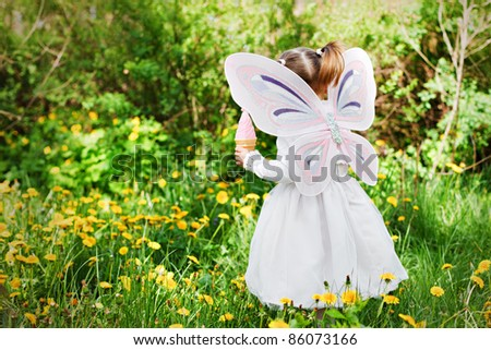 sweet girl with butterfly wings - stock photo