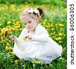 sweet girl with dandelions - stock photo
