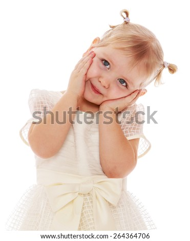 Sweet girl with two ponytails hanging on to cheeks and tilted his head to the side - stock photo