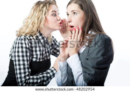 sweet gossips between two girlfriends standing isolated over white background
