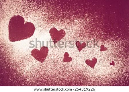 Sweet heart drawing in powder sugar - stock photo