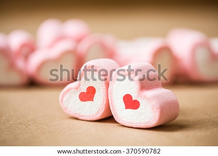 sweet heart shape of marshmallows on wooden background,decoration for love and valentine day concept. - stock photo