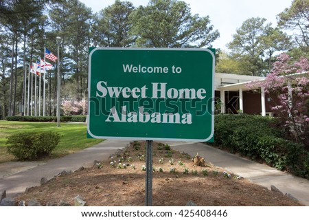 sweet home alabama welcome sign at rest area stop off highway - stock photo