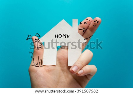 Sweet home. Hand holding white paper house figure on blue background. Real Estate Concept. Ecological building. Copy space top view. - stock photo