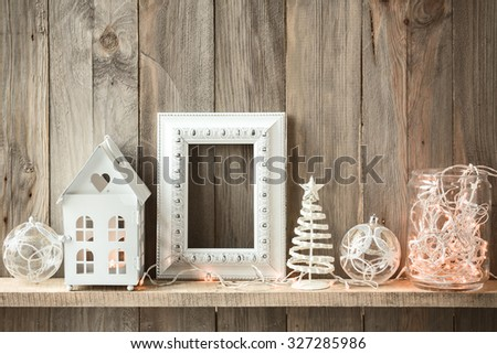 Sweet home. White Christmas decor on vintage natural wooden background. Empty photo frame. - stock photo