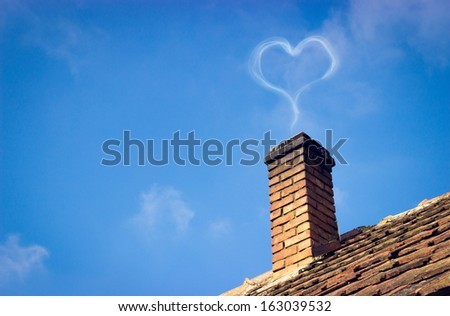 Sweet home with full of love. Heart shaped smoke coming from the chimney. - stock photo