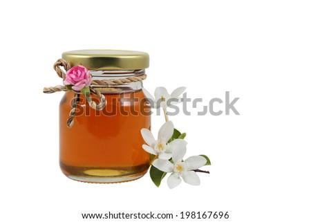 Sweet honey in jar isolated on white - stock photo