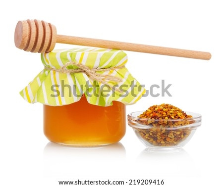 Sweet honey in jar isolated on white background - stock photo