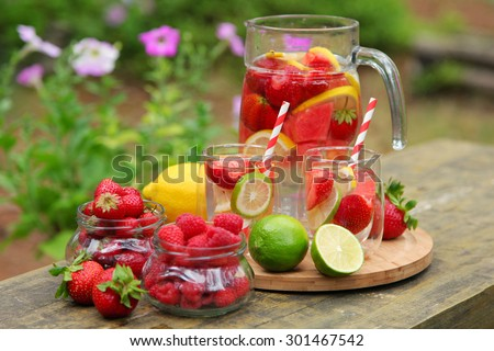 sweet ice tea with fruits - stock photo