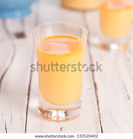 Sweet italian liqueur with eggs, square image - stock photo