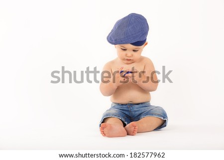 Sweet little baby boy sitting on white background