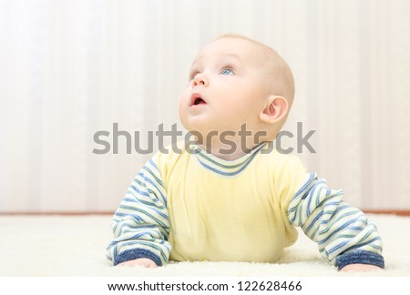 sweet little baby face  looking up - stock photo