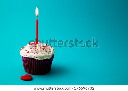 sweet little birthday cake with candles - stock photo