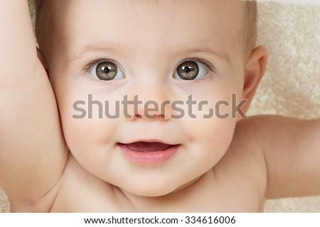 Sweet little boy sitting on studio white background - stock photo
