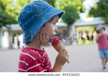 Sweet little child, boy, eating ice cream  - stock photo