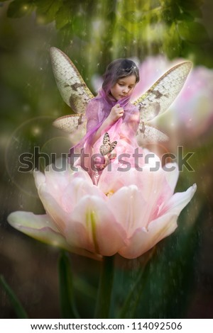 Sweet little fairy in a pink tulip - stock photo