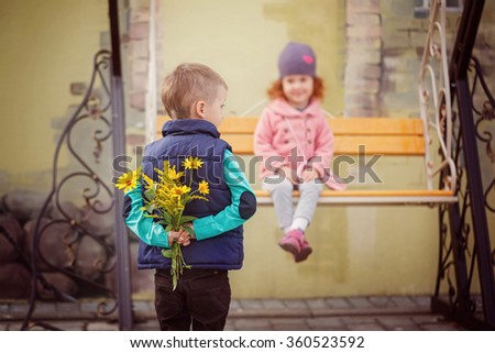 Sweet little girl and cute boy have a date in city. Valentine day  concept. - stock photo