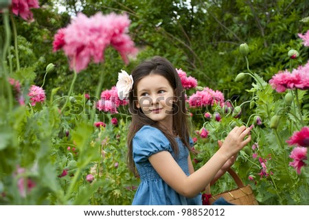 sweet little girl in the garden with wild poppies - stock photo