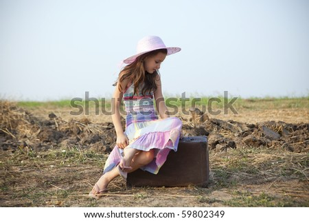 sweet little girl on the road - stock photo