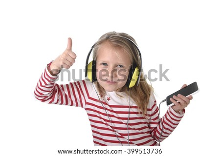sweet little girl 7 years old with blonde hair and blue eyes listening to music with headphones and mobile phone giving thumb up enjoying song happy isolated on white background - stock photo