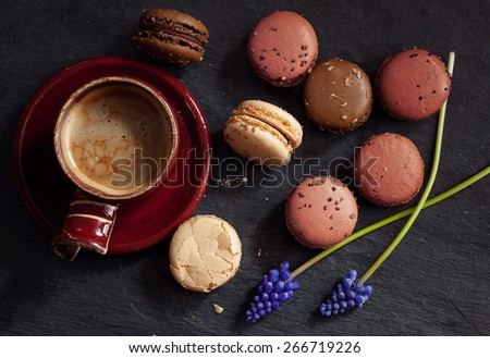 Sweet macaroons with cup of coffee - stock photo