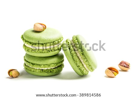 Sweet macaroons with pistachio on white background - stock photo
