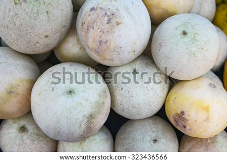 Sweet Malaysian honeydew melon selling at local sunday market. Selective focus with shallow depth of field.