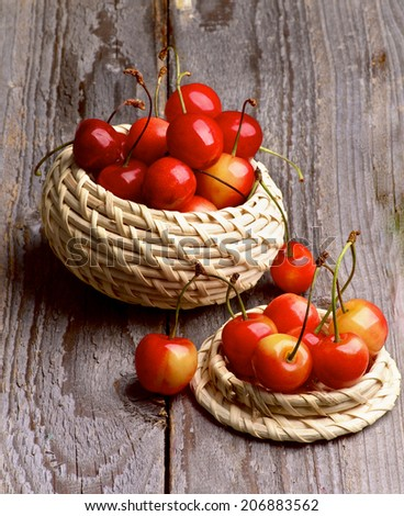 Sweet Maraschino Cherries in Two Wicker Bowls on Rustic Wooden background - stock photo