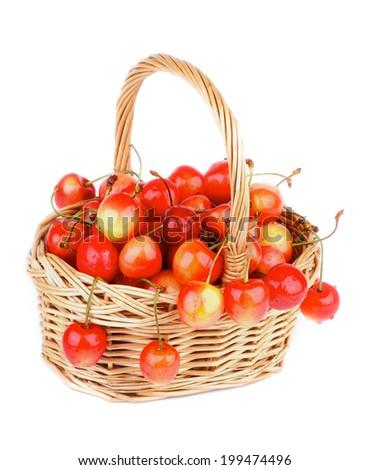 Sweet Maraschino Cherries in Wicker Basket isolated on White background - stock photo