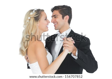 Sweet married couple dancing viennese waltz smiling at each other  - stock photo