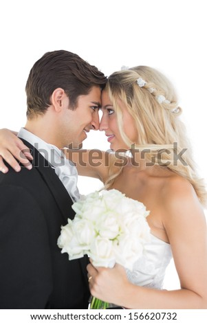 Sweet married couple looking each other in the face on white background - stock photo