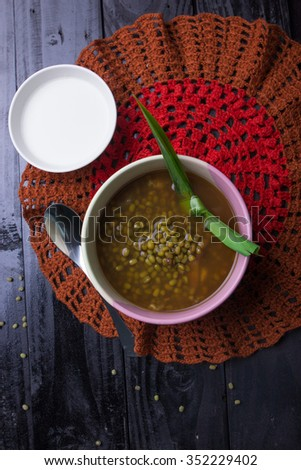 Sweet mung green beans porridge with sugar, pandan leaves and coconut milk
